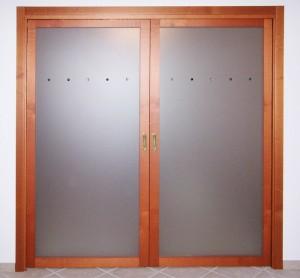 Porta in legno a due ante scorrevole interno muro